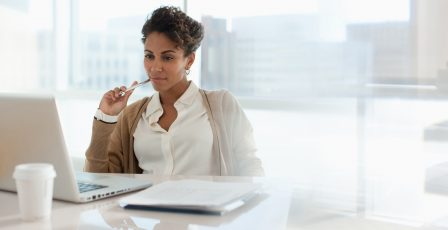 Woman at desk making decisions